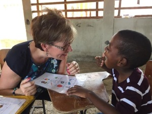 Becky, a speech therapist helping this child in Corazal with speech difficulties