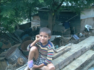This is a young boy who lives at the La Ceiba dump.