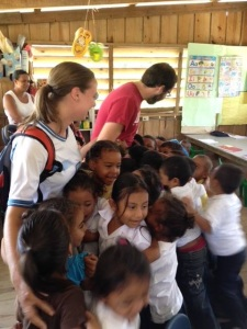 Jill and Jon receiving a loving welcome from the students in Porvenir