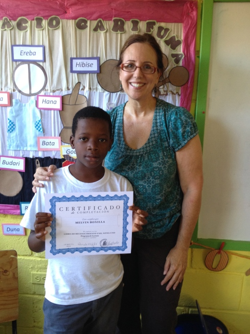 Melvin, proud to receive a well-earned certificate. He completed the first part of the new reading program in record time. He could not read before…..He can now!!
